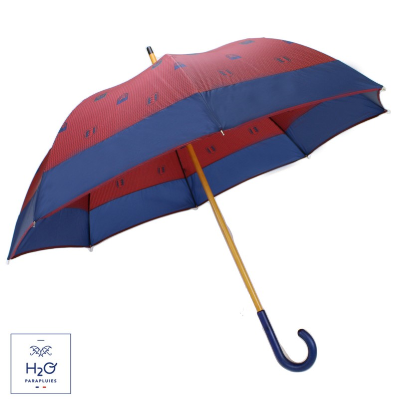 Red half golf umbrella with blue coat-of-arms
