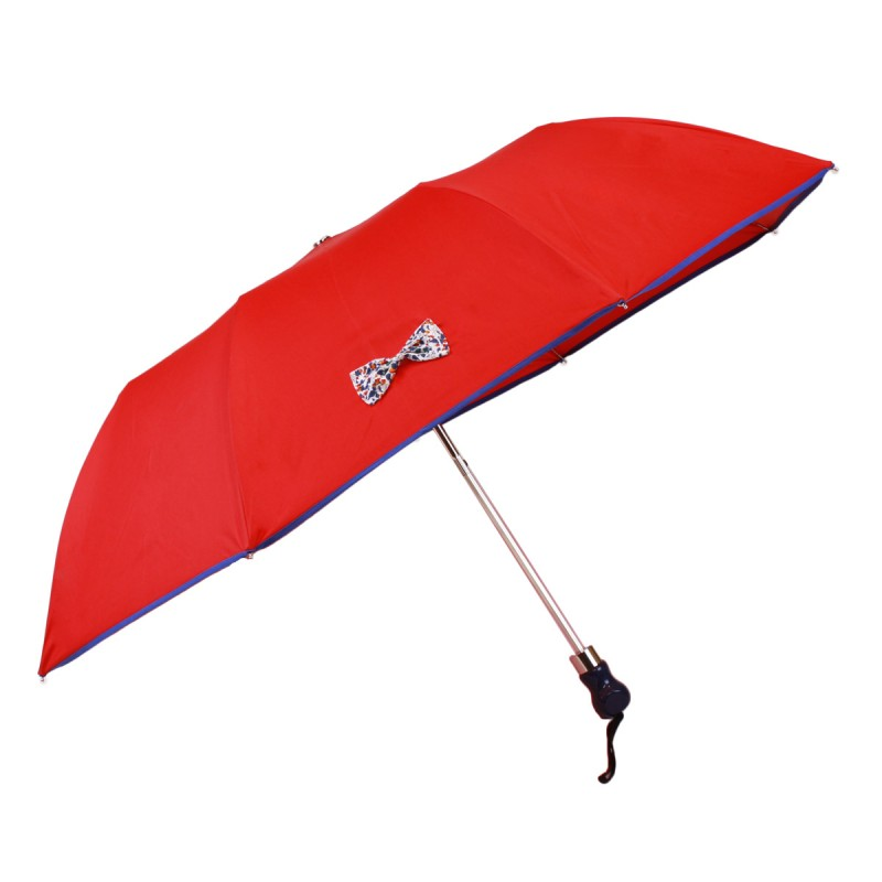 Red folding umbrella with small floral bow