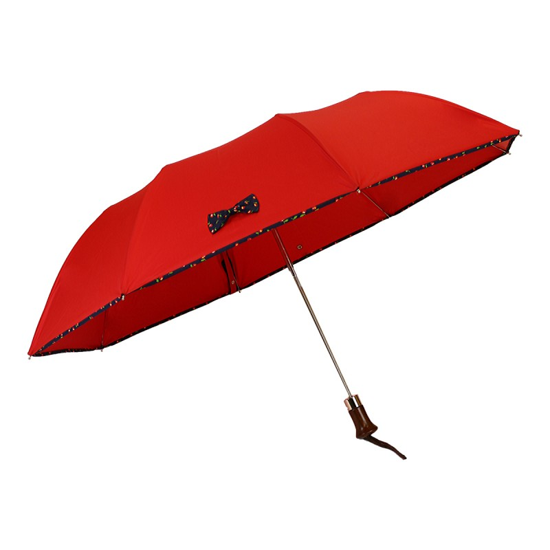 Red folding umbrella with apple bow