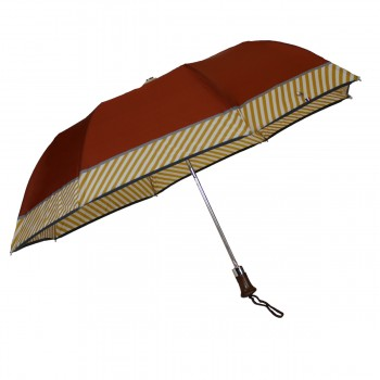 Brown folding umbrella with...